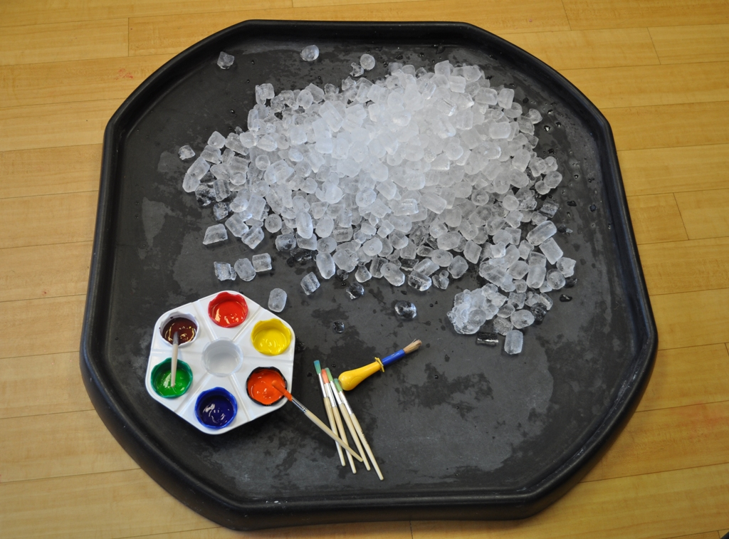 Toddlers painting ice cubes