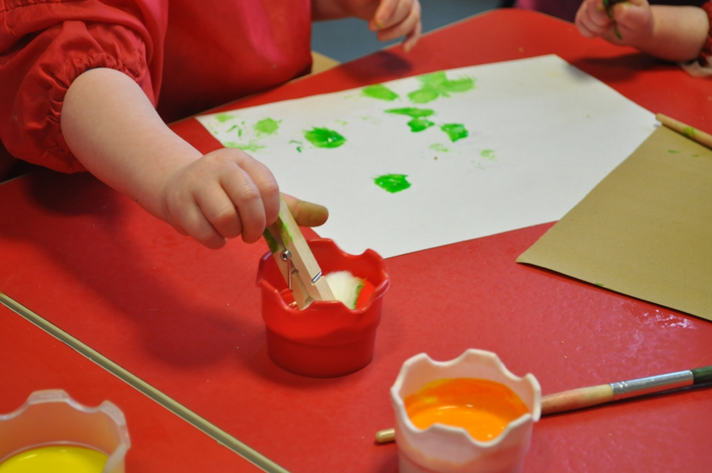 Dipping cotton wool in paint for mark making